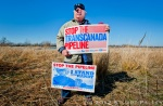 "Tom Genung of Hastings, NE poses in front of the South Branch of the Platte River. Genung is an adrent opponent of Trans Canada's failed bid to build the Keystone XL Pipeline across the Nebraska Sandhills and Ogalalla Aquifier. He is part of an informal group he calls the ""Sheriff's Posse"" and testified in front of Nebraska's Unicameral Legislature against the Keystone Pipeline XL construction. Genung and his fellow Nebraskans have been successful in stopping the bid for the time being, but still face efforts from Trans Canada to expand capacity to pump hot tar sands from Alberta, Canada South to oil refineries in Houston and the Gulf Coast area."