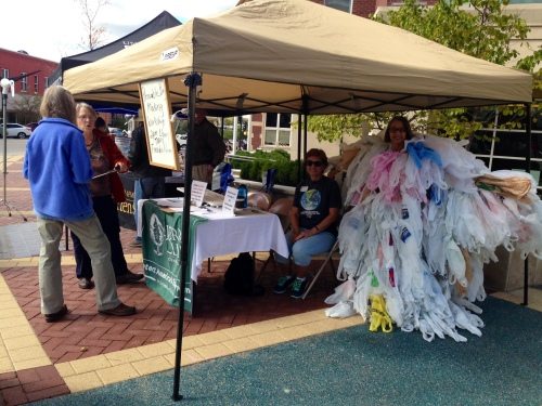 Osage Sierra Club Chapter volunteers encourage passers-by to sign their petition of support for a single-use plastic bag ban in Columbia at the 2014 Sustainable Living Fair outside city hall Saturday. (Photo by Jessica Stone.)